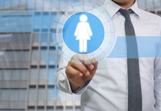 Hand of businessman pointing to a blue button and have women log. O for concept of human resources stock photos