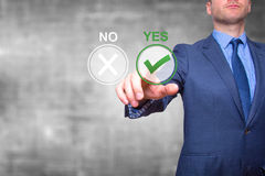 Hand of businessman press Yes button. Concept of decision making royalty free stock photography