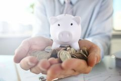 Hand businessman putting pin money stock images