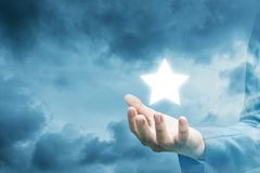 Hand of a businessman showing star. stock images