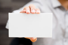 Hand of businessman showing white paper Royalty Free Stock Photos