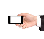 Hand of a businessman in a suit holding a phone with isolated di Stock Image