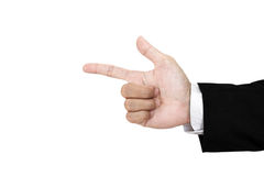 Hand of businessman in suit showing gun sign, isolated on white background Royalty Free Stock Photos
