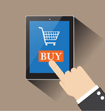 Hand of businessman touching buy on screen table computer. With Shopping cart Stock Images