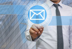 Hand of businessman use finger touch icon of envelope or e-mail. System for idea presentation in your organization and work Stock Photos