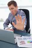 Hand of businessman used to signal stop Royalty Free Stock Image