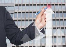 hand of businessman using blue pen pointing to top arrow graph o Royalty Free Stock Photos