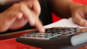 Hand of businessman using a calculator stock video