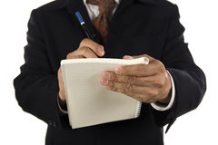 Hand of Businessman write on notebook Stock Photo