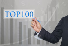 Hand of businessman Write a text of TOP100. Stock Image