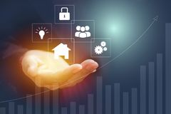 Hand of businesswoman holding house icon concept.  Royalty Free Stock Photography