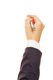 Hand of businesswoman holding pen. Hand of a businesswoman holding a ballpoint pen Royalty Free Stock Photos
