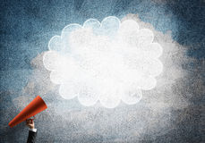 Hand of businesswoman holding red paper trumpet and speech cloud Royalty Free Stock Photography