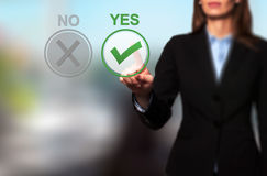 Hand of businesswoman press Yes button Royalty Free Stock Image