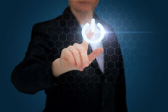 Hand of a businesswoman pressing power. Hand of a businesswoman pressing power button Stock Photography