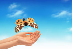 Hand and a butterfly Royalty Free Stock Photos