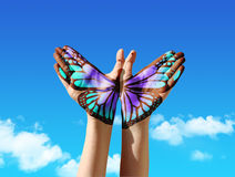 Hand and butterfly hand painting. Tattoo, over a blue sky, concept for spiritual symbol of soul Royalty Free Stock Photo