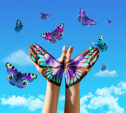 Hand and butterflys. Hand and butterfly hand painting, tattoo, over a blue sky, concept for spiritual symbol of soul royalty free stock photography