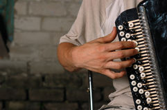 Hand with button accordion Royalty Free Stock Image