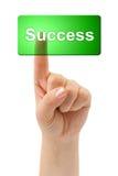 Hand and button Success Stock Photos