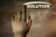 Hand and button with word of solution Stock Photos