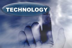 Hand and button with word of technology Royalty Free Stock Photo