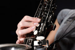 Hand on buttons of saxophone Royalty Free Stock Image