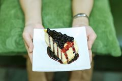 Hand and Cake of the Girl Delicious desserts Snacks of health lo royalty free stock image