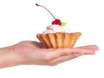 Hand with cake Royalty Free Stock Image