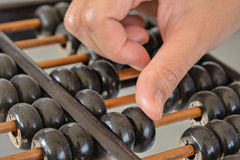 Hand calculated on Old abacus Stock Image