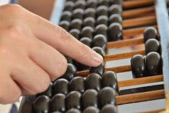 Hand calculated on Old abacus Stock Photo