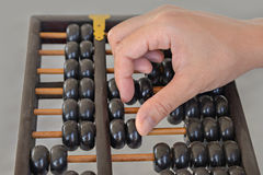 Hand calculated on wooden abacus Royalty Free Stock Photos