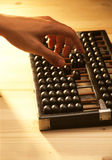 Hand calculating using abacus Stock Photography