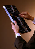 Hand calculating using abacus Stock Image