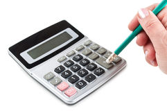 Hand and calculator Stock Photos