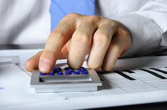Hand and calculator Royalty Free Stock Images