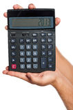 Hand with calculator Stock Image