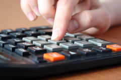 Hand on the calculator Stock Image