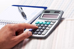 Hand with calculator. Stock Photography