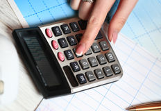 Hand with calculator Stock Photos