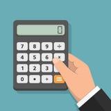 Hand with Calculator Stock Photo