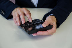 Hand with calculator Royalty Free Stock Image