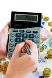 Hand with calculator and money Royalty Free Stock Photos