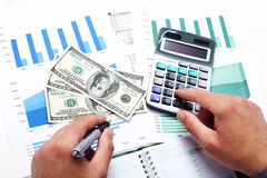 Hand with calculator and money. Stock Photography