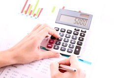 Hand, calculator and pen Stock Photos