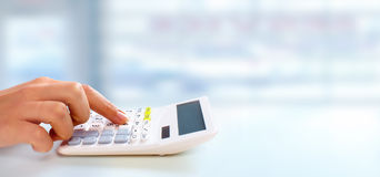Hand with calculator. Hand of professional accountant with calculator. Accounting tax service Royalty Free Stock Image