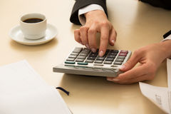 Hand on calculator. Stock Image
