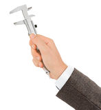 Hand with caliper Stock Images