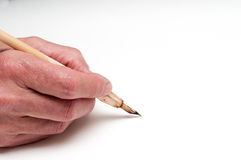 Hand with calligraphy pen Royalty Free Stock Photos