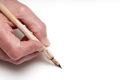 Hand with calligraphy pen Royalty Free Stock Photo
